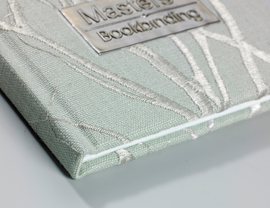 Material over board, case bound book