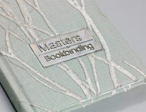 Material over board, case bound book