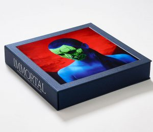 Square box with metallic cover material